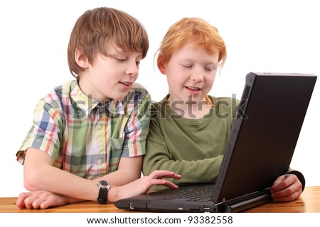 Boy and girl working together on a laptop computer