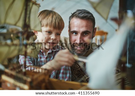 Boy and his father - stock photo