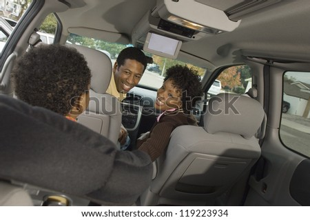 Boy and his parents in a minivan - stock photo