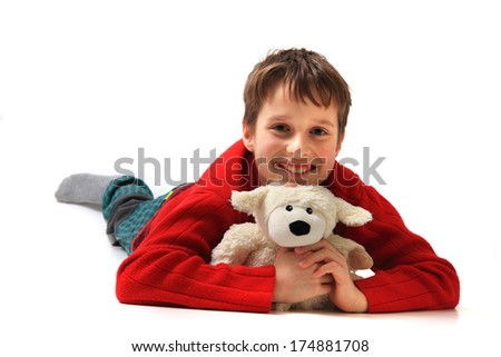 boy and his sheep toy isolated on the white background - stock photo