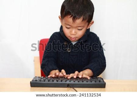 Boy and keyboard - stock photo