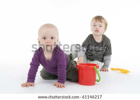 Boy and little girl with pail and shovel on white background.