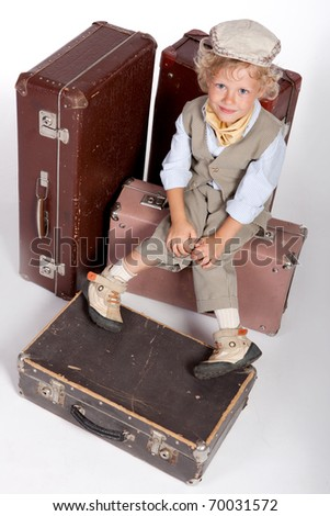 boy and old suitcases.