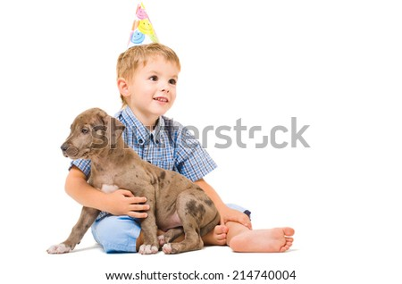 Boy and puppy pitbull of given a present to birthday - stock photo