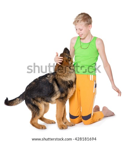 Boy and puppy shepherd dogs on a white background - stock photo
