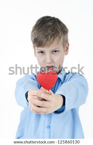 Boy and red heart. Valentines Day concept. - stock photo