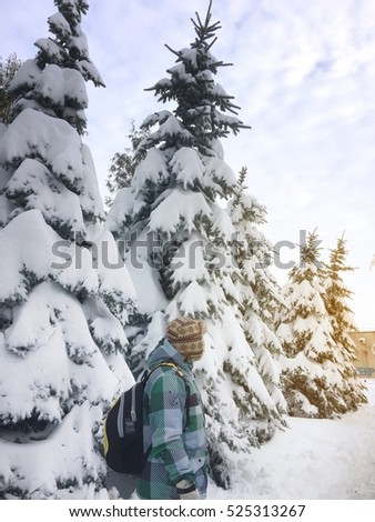 boy and snow-covered trees