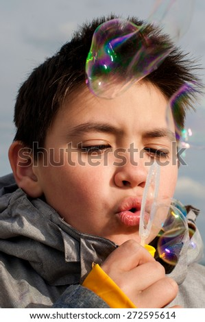 Boy and soap bubbles