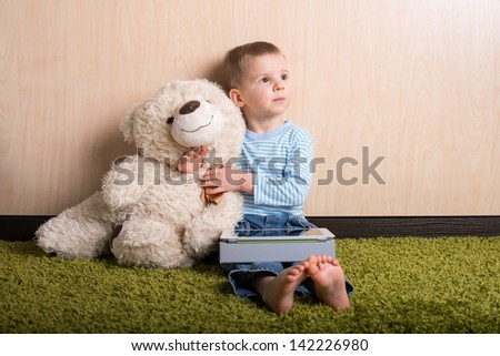 Boy and teddy bear with tablet computer, dreamy - stock photo