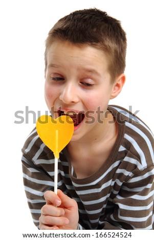 boy and yellow lolipap (heart shape) - stock photo