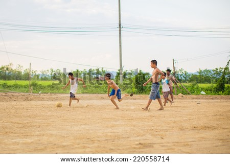boy are playing football - stock photo