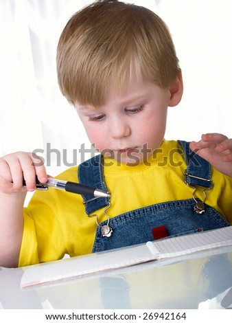 Boy at his desk - stock photo
