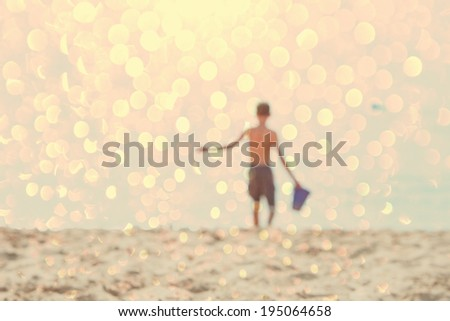 boy at the beach, defocused image - stock photo