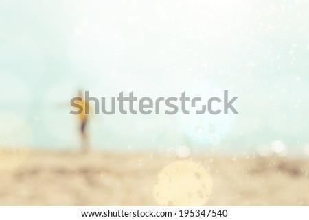 boy at the beach, defocused image - stock photo
