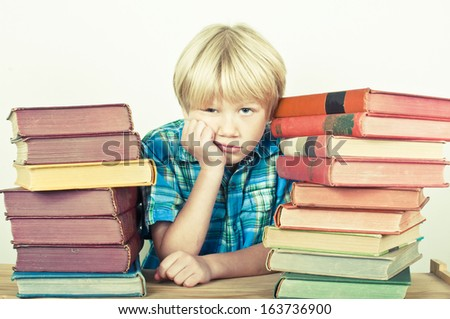 Boy at the library - stock photo