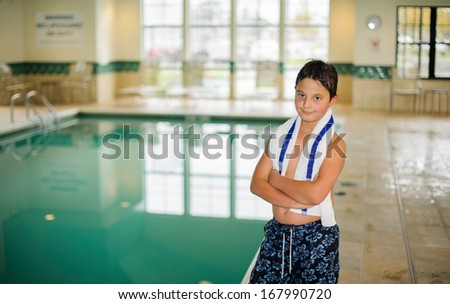 Boy at the pool - stock photo