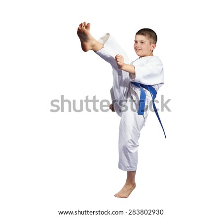 Boy beats kick mae-geri on a white background