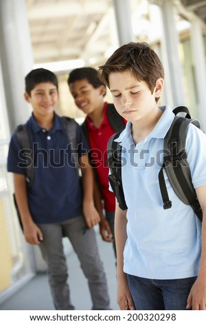 Boy being bullied in school - stock photo