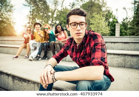 Boy being bullied in school - Young students making fun of a young boy at high school - stock photo