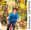 Boy biking - stock photo