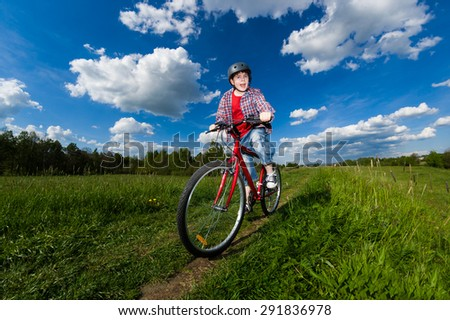 Boy biking - stock photo