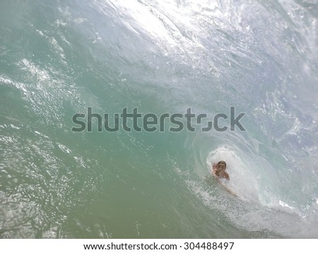 Boy Bodysurfing Tube 02