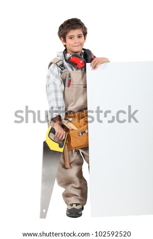 Boy builder with a board left blank for your message - stock photo