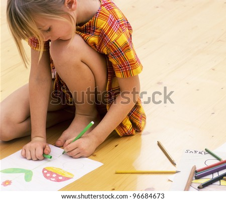 Boy building a card house. - stock photo