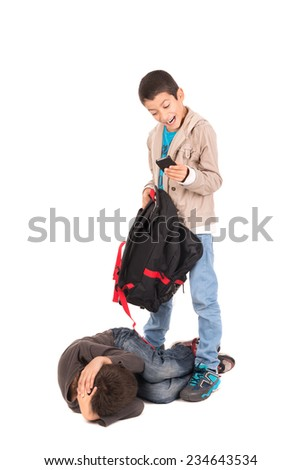 Boy bullying and stealing from a smaller one isolated in white - stock photo