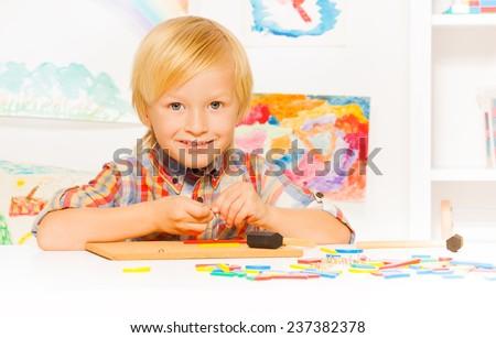 Boy busy with developmental game - stock photo