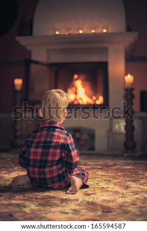 Boy by fireplace