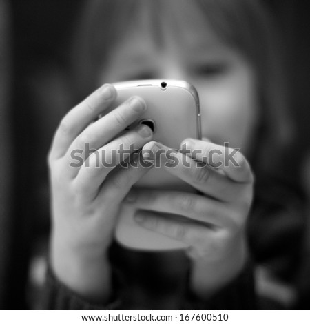 Boy, calling cell phone - stock photo