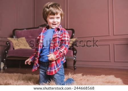 Boy,Carpet, sofa - stock photo
