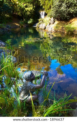 Boy caught a big fish sculpture on Kauai Hawaii. More with keyword Series001G