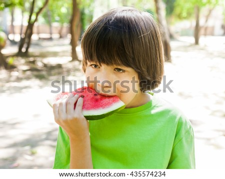 boy child eating watermelon during sunny day