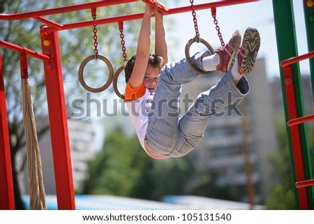 boy child outdoors playing on playground - stock photo