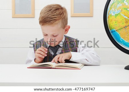 Boy Child Read Book, Children Education, funny Schoolboy.student in class at the elementary school.Fashion portrait