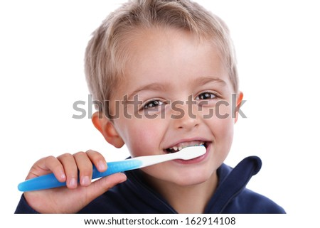 Boy child with toothbrush brushing teeth at bedtime concept for dental care - stock photo