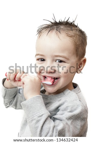 Boy cleaning his teeth