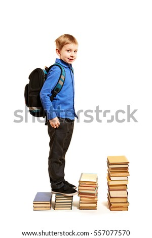 Boy climbing the stairs of books