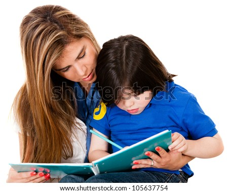 Boy coloring a book with his mother - isolated over white background