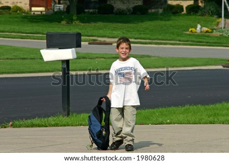 Boy Coming Home from School with Backpack - stock photo