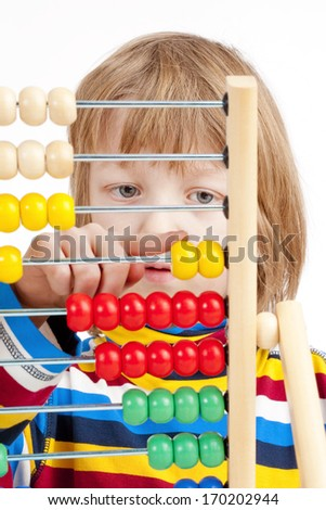 Boy Counting on Colorful Wooden Abacus - Isolated on White - stock photo