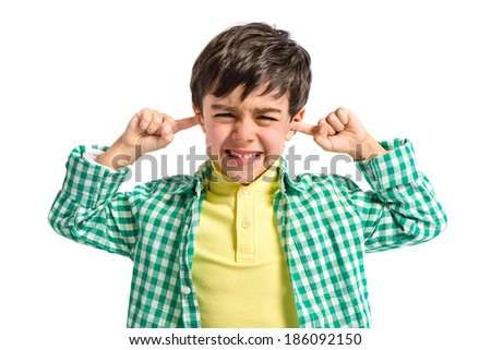 Boy covering his ears over white background.  - stock photo
