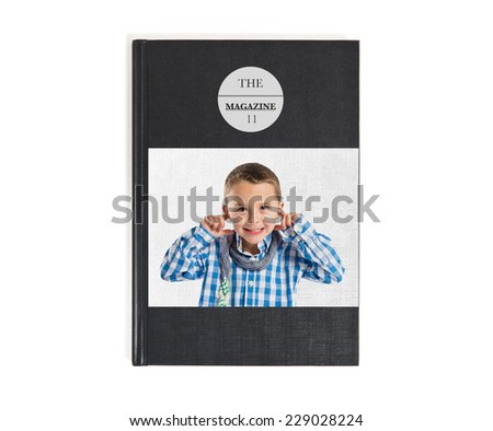 Boy covering his ears printed on book - stock photo