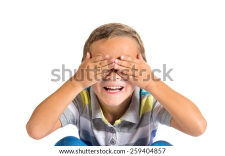 Boy covering his eyes