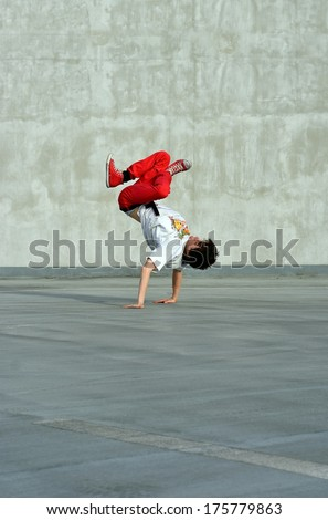 Boy dancing on the street