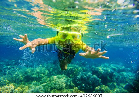Boy dives in a tropical sea