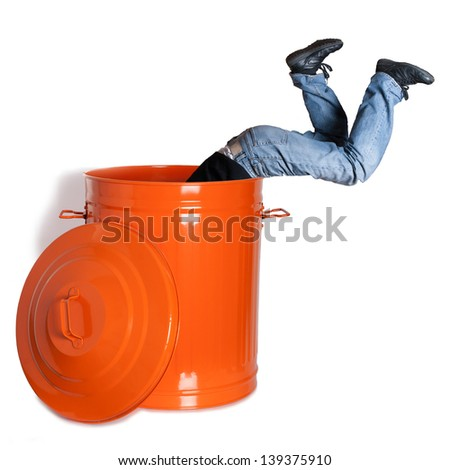boy dives into a garbage can - stock photo