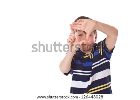 boy doing a visual frame on a white background - stock photo